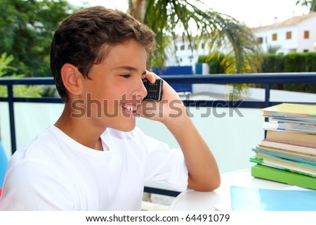 Boy teen talking mobile phone happy smiling student outdoor garden - stock photo