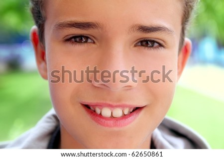 boy teenager closeup face macro happy smiling outdoor green garden - stock photo