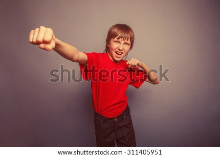 Boy, teenager, twelve his years  red  in shirt, fists  red showing retro - stock photo