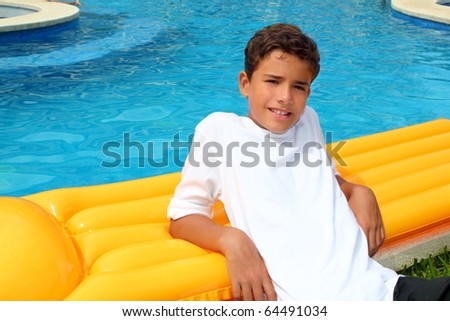 boy teenager vacation holidays rest on yellow pool float - stock photo