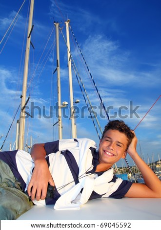 boy teenager vacation laying marina boat smiling summer vacation - stock photo