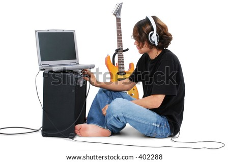 Boy Teenager With Electric Guitar Amp And Laptop. - stock photo