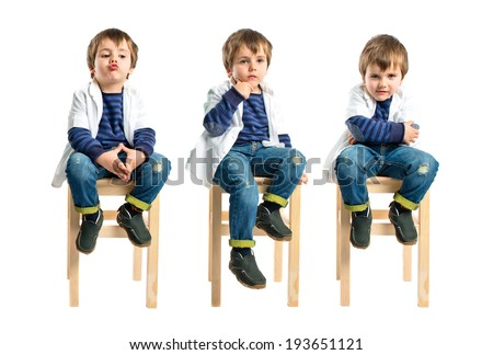 Boy thinking on wooden chair over white background