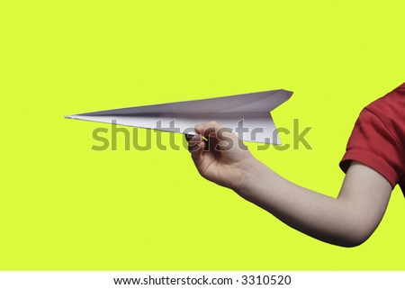 Boy throwing a paper plane..