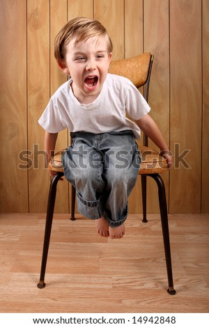 Boy throwing a tantrum while sitting on a timeout - stock photo