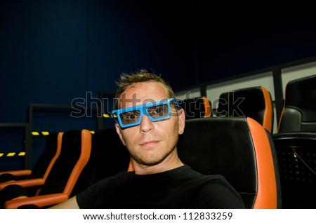 boy to the movies with 3d glasses - stock photo