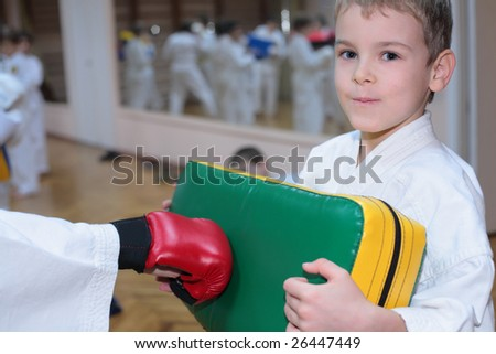 boy trains in sports hall - stock photo