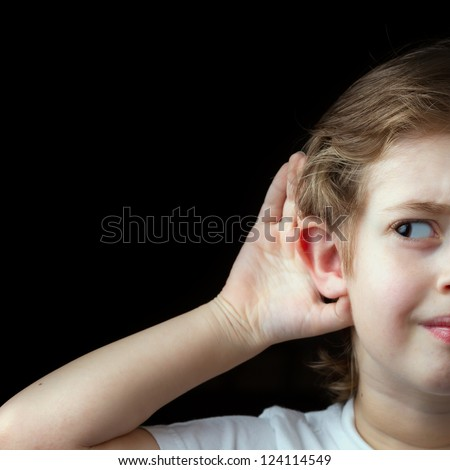 Boy Trying to hear something - stock photo