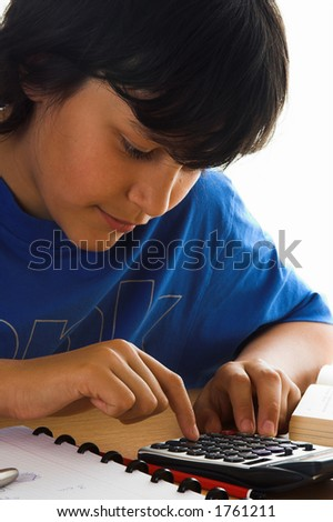 Boy using a calculator