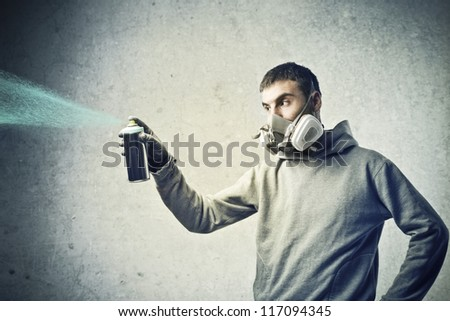 Boy using a color spray - stock photo