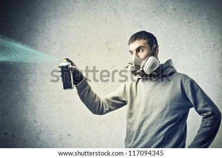 Boy using a color spray - stock photo