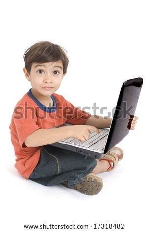 Boy using a laptop on white background .