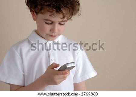 Boy using a mobile phone