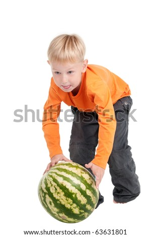 Boy using a watermelon instead of ball - stock photo