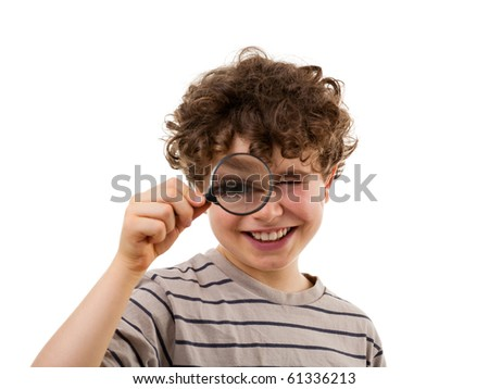 Boy using magnifying glass - stock photo