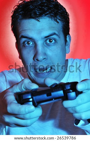 Boy using the video game controller and joyfully playing video games. - stock photo