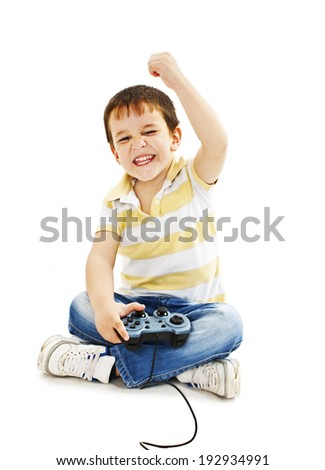 Boy using video game controller.   Isolated on white background  - stock photo