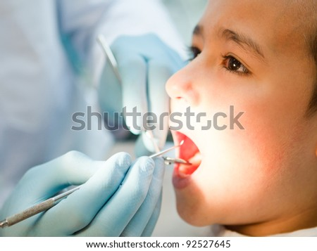 Boy visiting the dentist taking good care of his teeth - stock photo