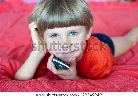 boy watches TV - stock photo