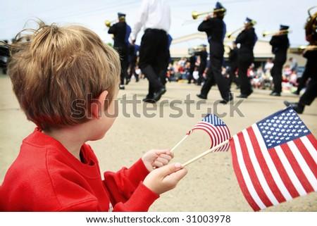 Boy watching a parade - stock photo