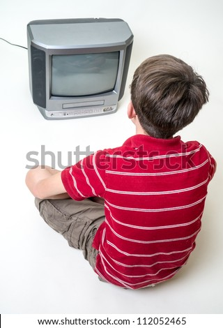 Boy Watching Television - stock photo