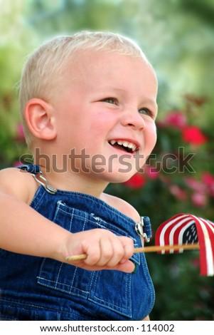 Boy waving flag - stock photo