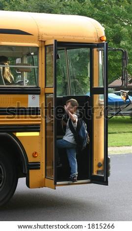 Boy Waving Getting on Bus - stock photo