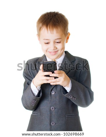 boy wearing a costume holding a cell-phone - stock photo