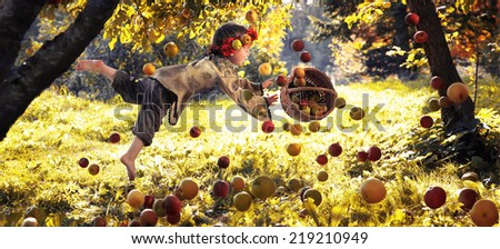 boy wearing a crown of apples flying through the orchard, surrounded by apples - stock photo