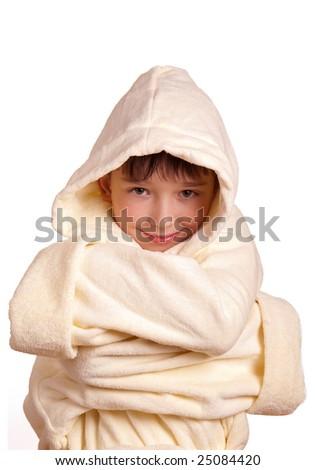 Boy wearing a yellow bathrobe isolated on white background - stock photo