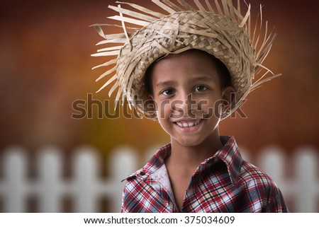 "Boy wearing ""Caipira"" clothes for the Junina Brazilian Party"