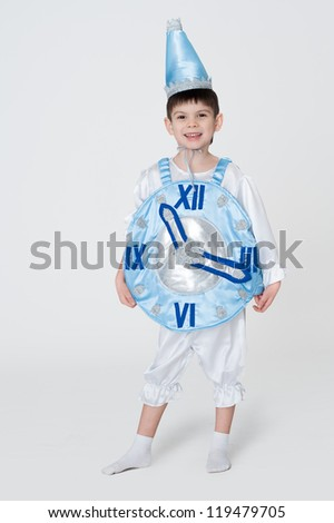 Boy wearing carnival costume of a clock isolated on white