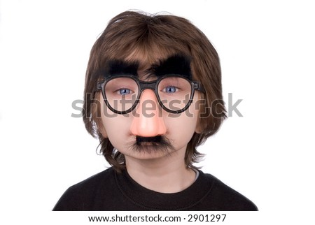 Boy wearing fake nose and glasses with mustashe and eyebrows over a white background - stock photo