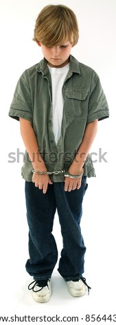 Boy wearing handcuffs - stock photo