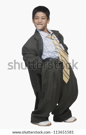 Boy wearing oversized suit and bending backward