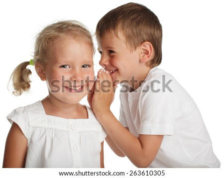 Boy whispers a secret to the girl - stock photo