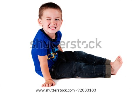 boy winking isolated in a studio - stock photo