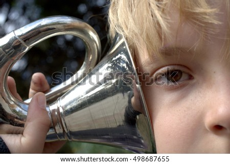 Boy with a big bicycle whistle