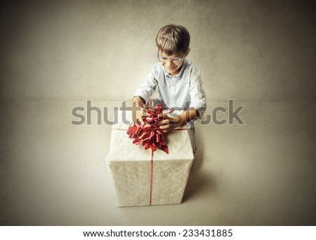 Boy with a big gift  - stock photo