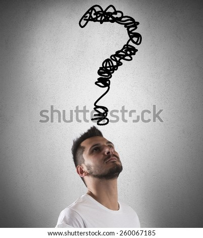 Boy with a big question on head - stock photo