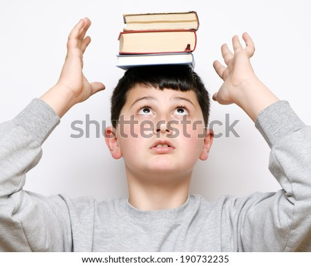 boy with a book on her head - stock photo