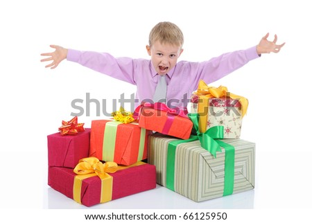 boy with a bunch of gifts . Isolated on white background - stock photo