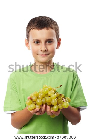 Boy with a cluster of ripe yellow grapes isolated on white background - stock photo