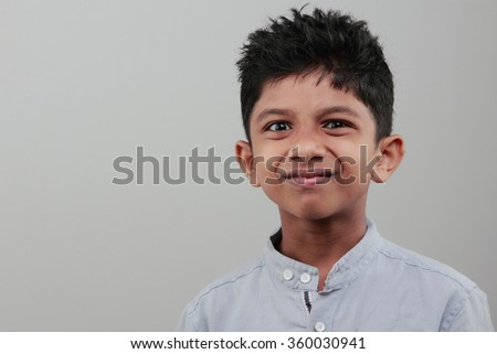 Boy with a confused smile - stock photo