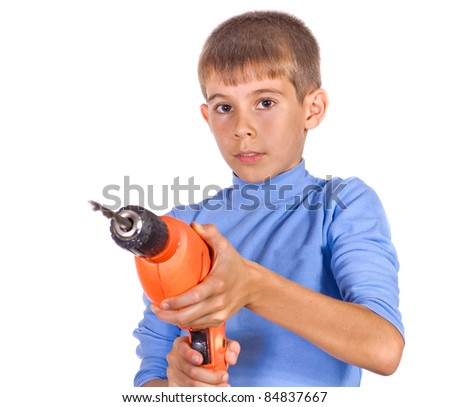 Boy with a drill. Isolated on white background - stock photo