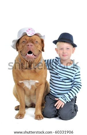 Boy with a Female dog in a hat - stock photo