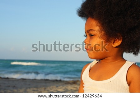 Boy with a funny facial expression - stock photo