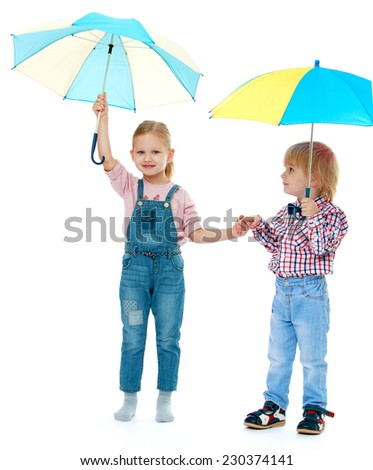 boy with a girl standing under a multi-colored umbrellas.Childhood education development in the Montessori school concept. Isolated on white background. - stock photo