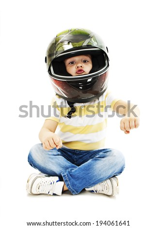Boy with a helmet, pretending to drive a motorcycle. Isolated on white background  - stock photo