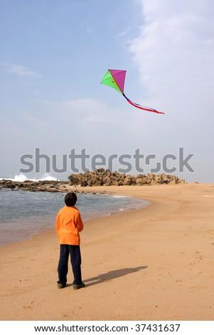 Boy with a kite - stock photo